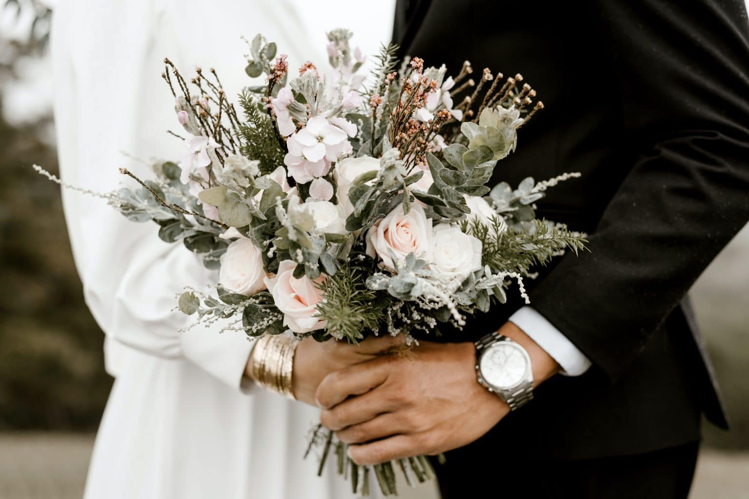 bridge-and-groom-standing-while-holding-flower-bouquet-2959192